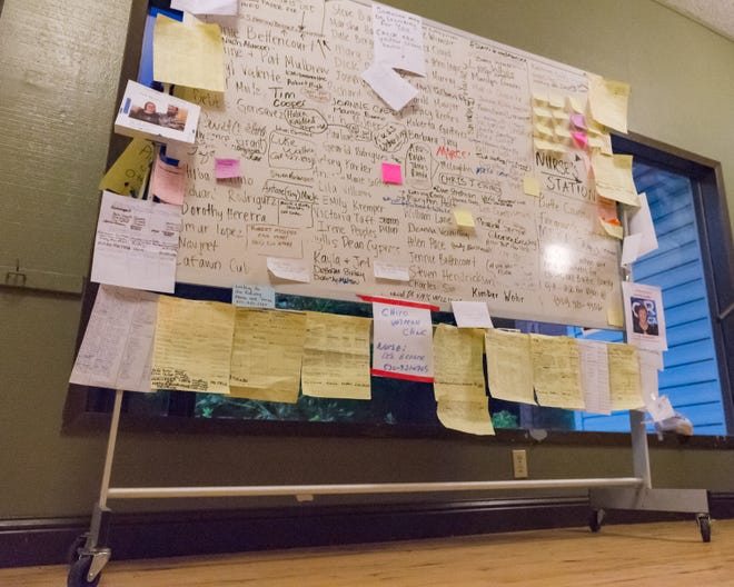 Names of missing posted on board at Red Cross Shelter by friends and relatives searching for loved ones. Sunday, Nov. 11, 2018.