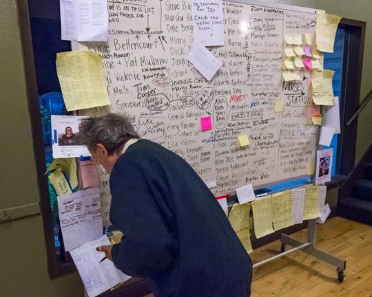 Names of missing posted on board at a Red Cross shelter by friends and relatives searching for loved ones Sunday, Nov. 11, 2018.