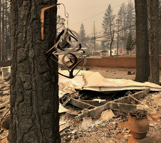 A house ornament continued to twirl at the Ridgewood Mobile Home Park in Paradise after the Camp Fire destroyed the park on Thursday in Paradise.