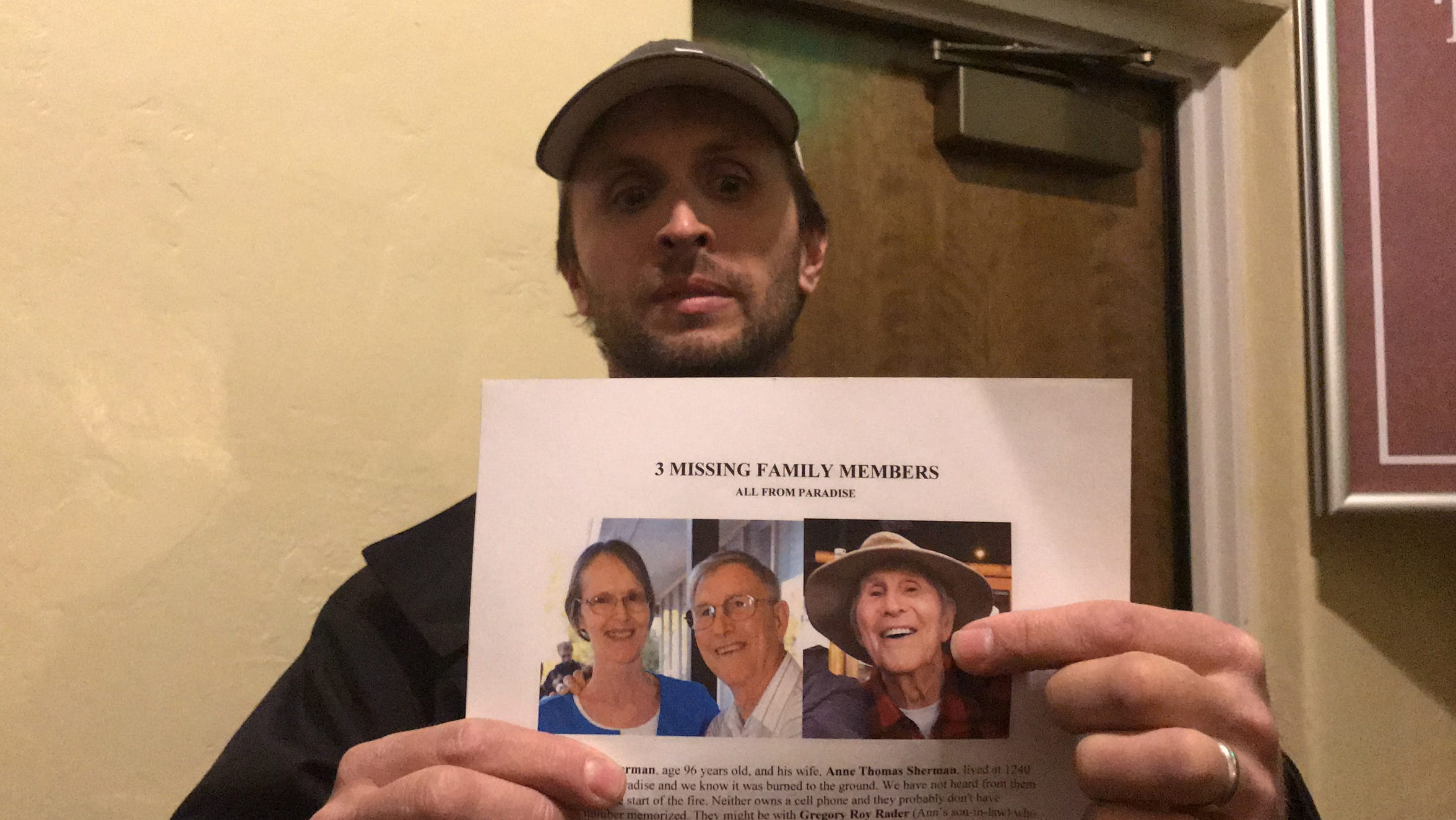 John Warner of Mi-Wuk Village, California, holds the flyer Nov. 10, 2018, that he made with photos of his grandparents missing in the Camp Fire in the Sierra Nevada town of Paradise.