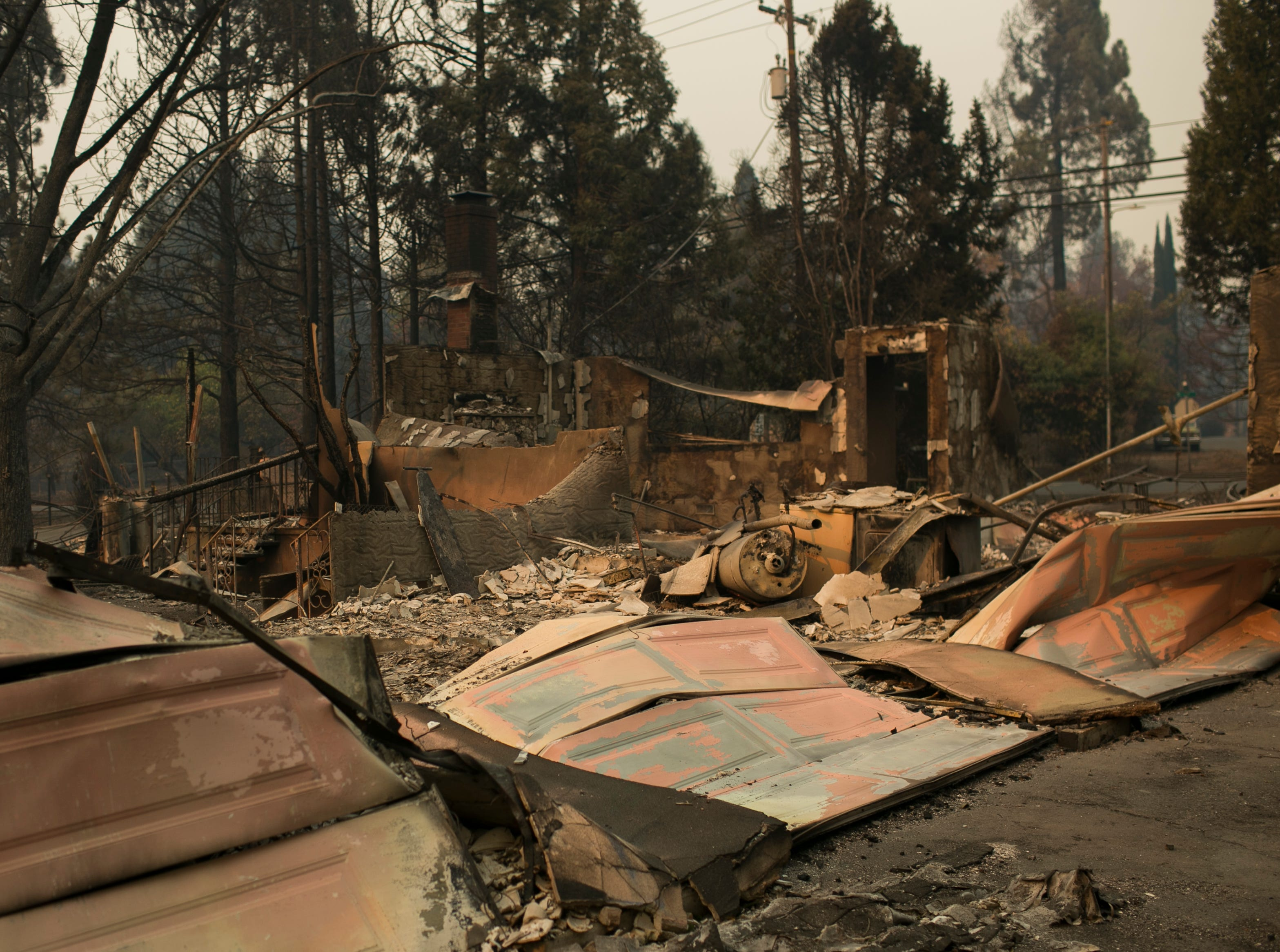 Housing remains sit empty days after the Camp Fire swept through town on Nov. 11, in Paradise, Calif.