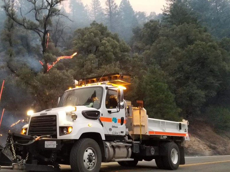 A Caltrans vehicle is parked close to the Cresta Powerhouse near Oroville on Monday morning. Highway closures remained in place in the area due to the Camp Fire in Butte County.