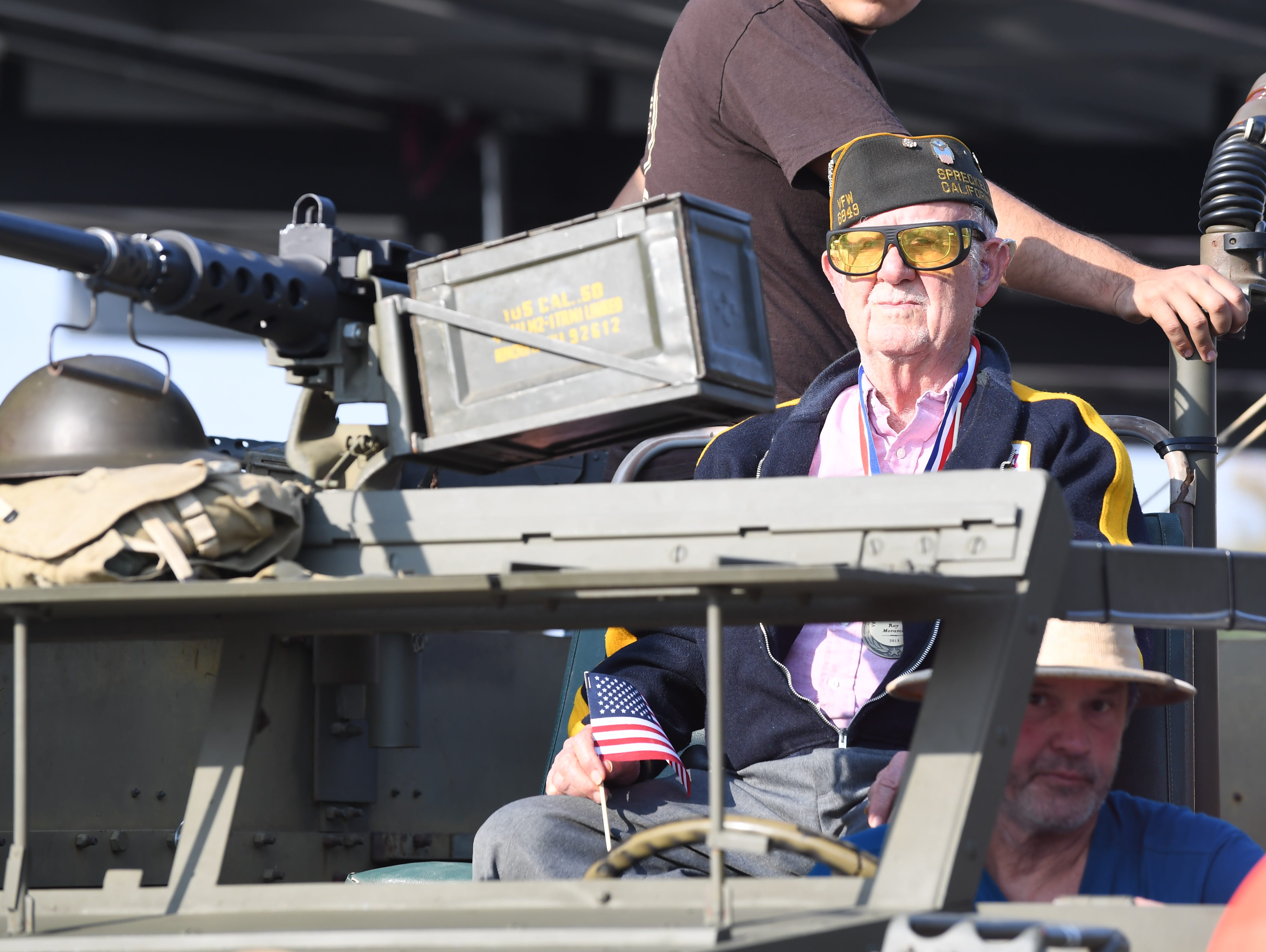 Ray Moranza, an Army veteran, waits for the Monterey County Veterans Day Parade to start on Sunday in Salinas.