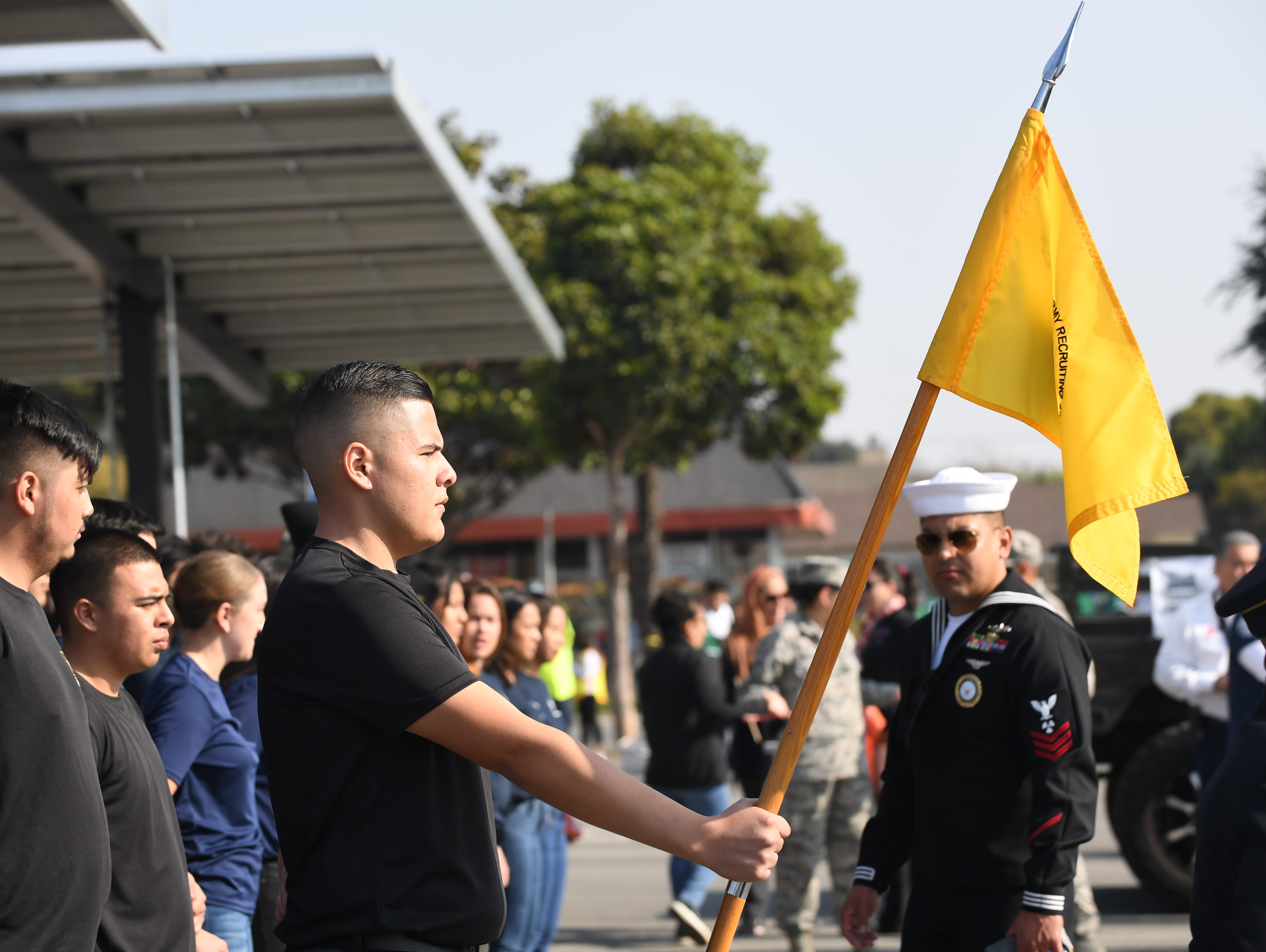 During Sunday's Monterey County Veterans Day Parade, local residents beginning their military careers took part in a mass oath of enlistment surrounded by friends and family.