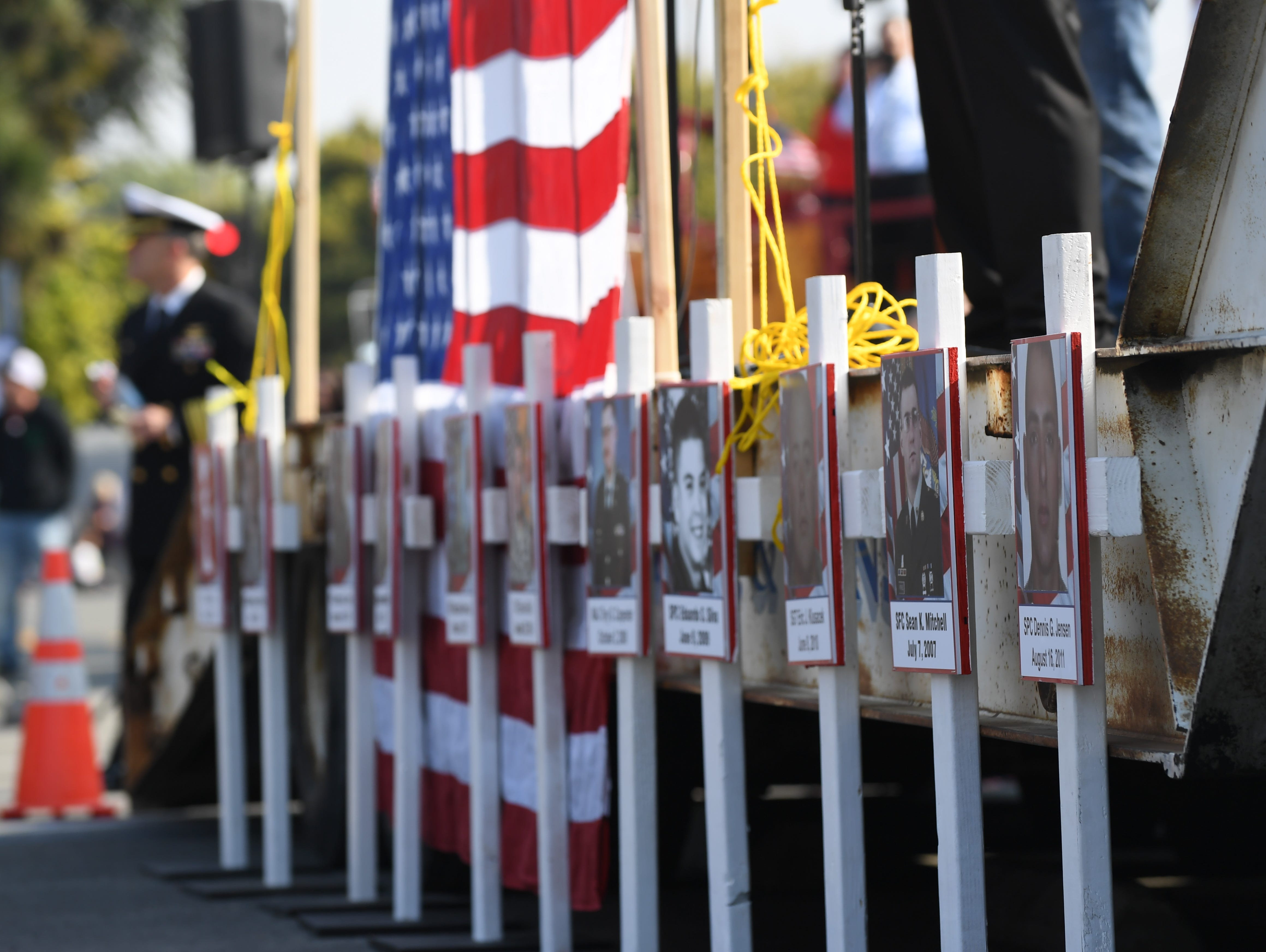 Crosses commemorating service members who have passed away were placed at the front of the Monterey County Veterans Day Parade in Salinas.