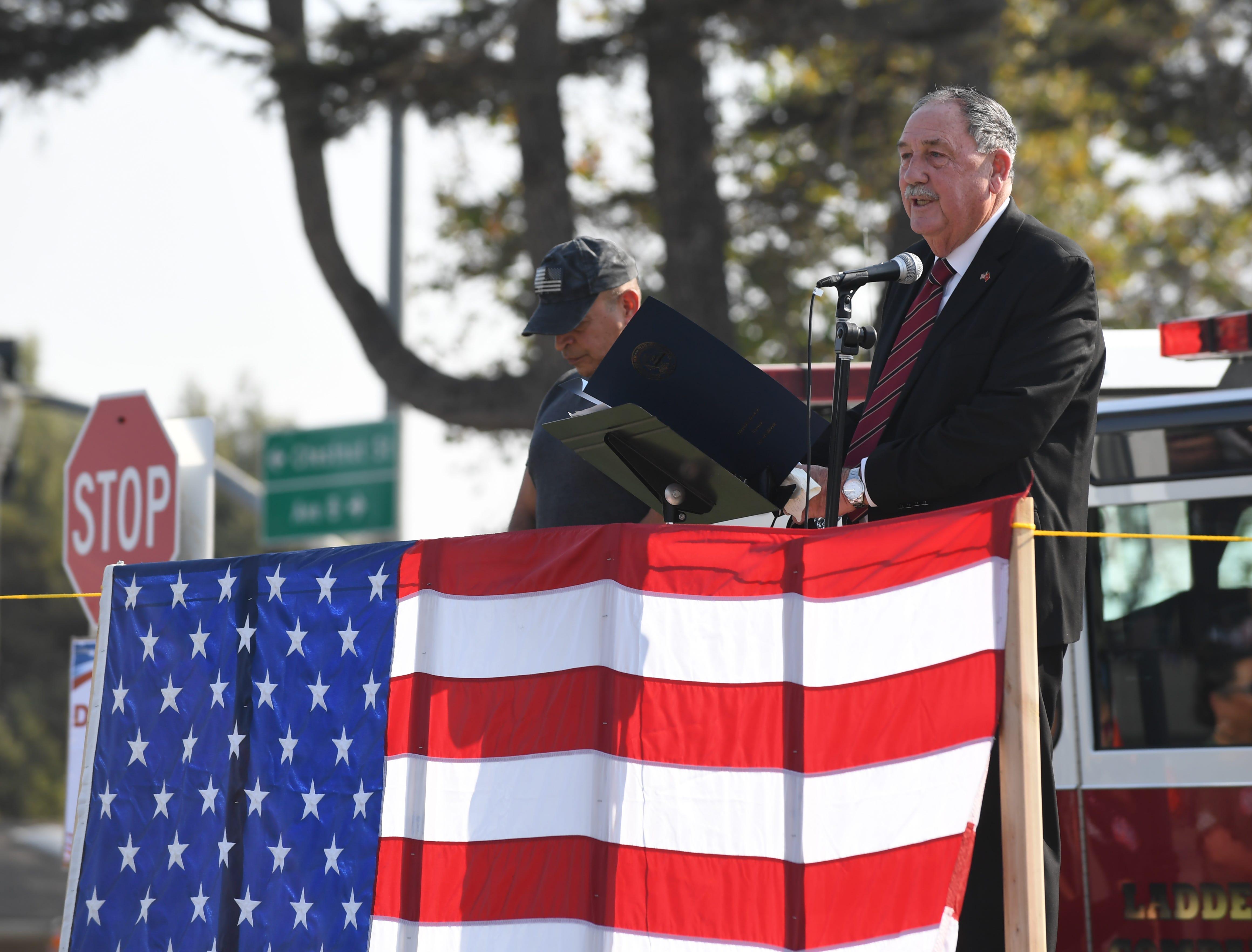 Mayor Joe Gunter, a Marine Corps veteran, addresses the crowd at Sunday's Monterey County Veterans Day Parade in Salinas.
