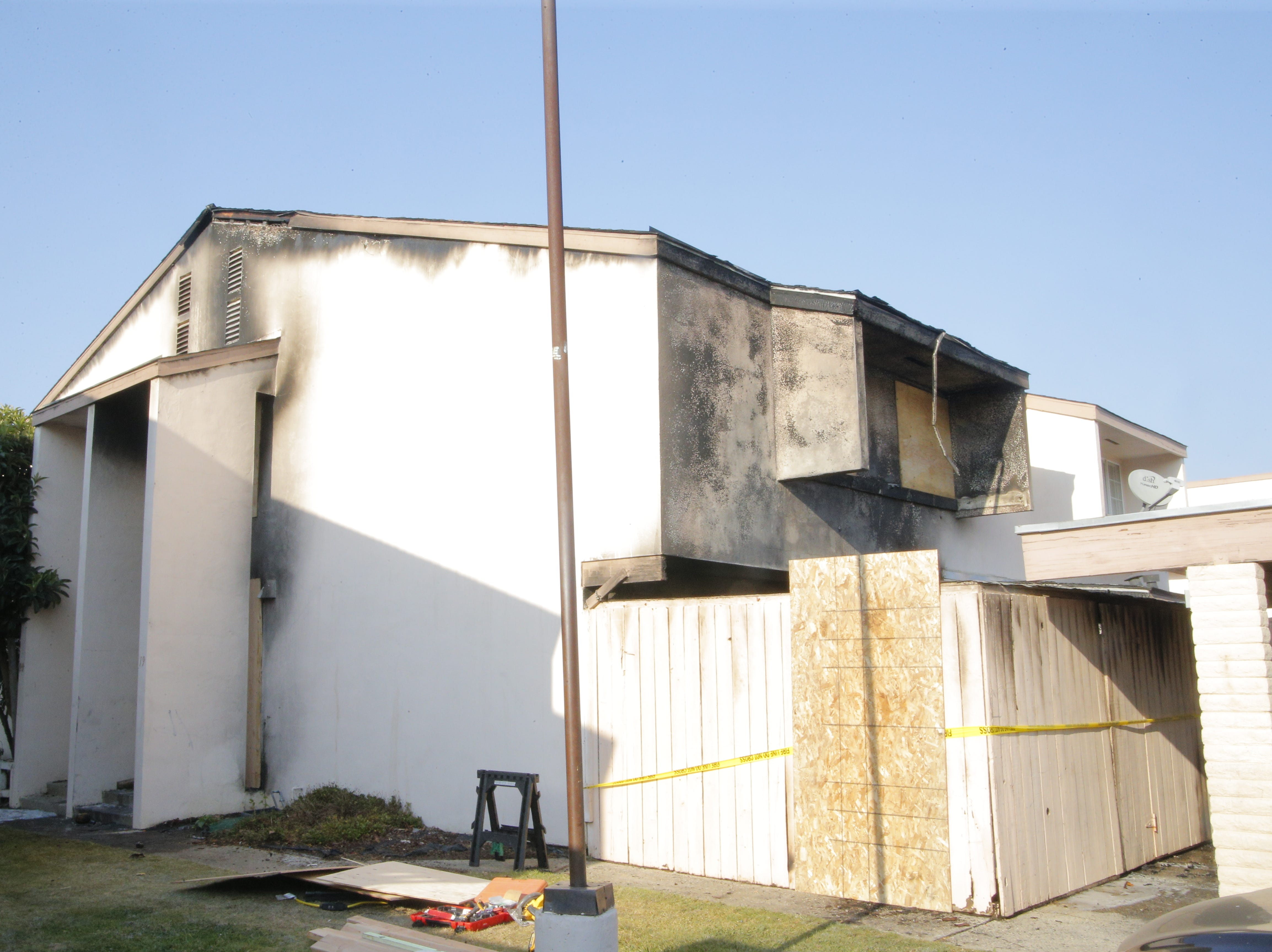 A fire tore through a two-story home in the 900 block of Acosta Plaza Monday morning.