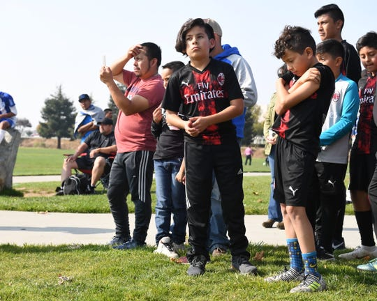 Soccer players and parents look on at Sunday's groundbreaking for the Salinas Regional Soccer Complex.