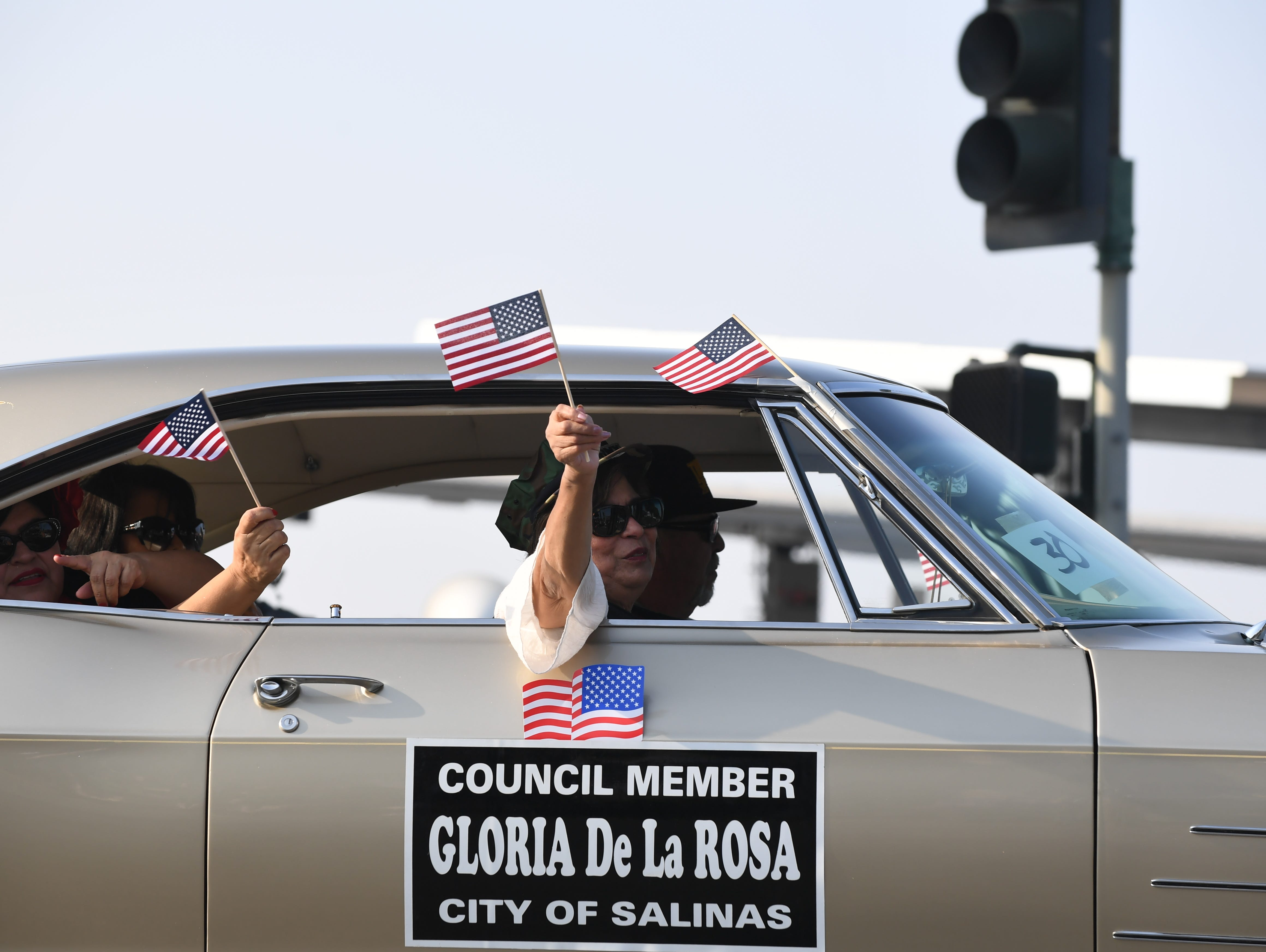 Councilwoman Gloria De La Rosa takes part in the eighth annual Monterey County Veterans Day Parade on Sunday in Salinas.