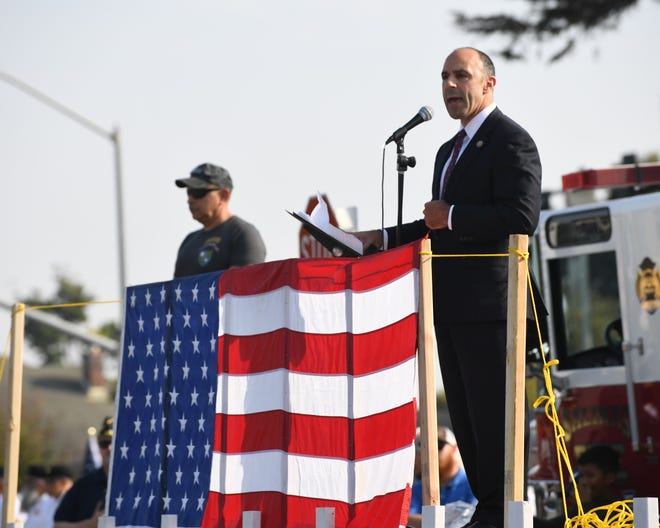 Rep. Jimmy Panetta, a Navy veteran, addresses the audience at the eighth annual Monterey County Veterans Day Parade.