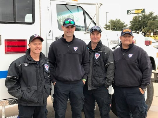 San Angelo firefighters prepare to travel to California to assist in fighting the deadly Camp Fire on Monday, Nov. 12, 2018, in San Angelo. From left to right are Battalion Chief Johnny Fisher, helmsman Jade Hughes, driver Blake Foster and helmsman Santos Chavez.