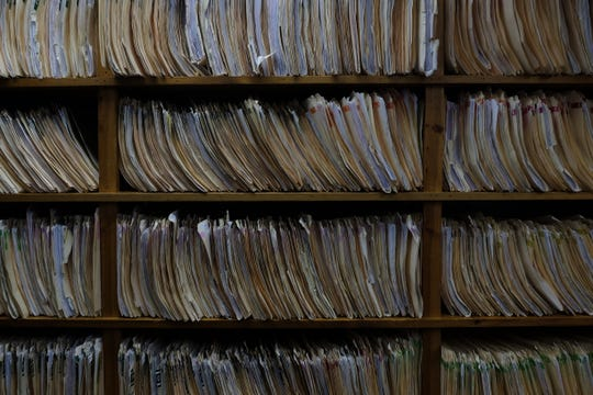 Several primary care physicians have said they spend more time filling out medical records than they do seeing their patients.  Dr. Paul Aguillon's office in Seaford has thousands of medical records  that span several walls.