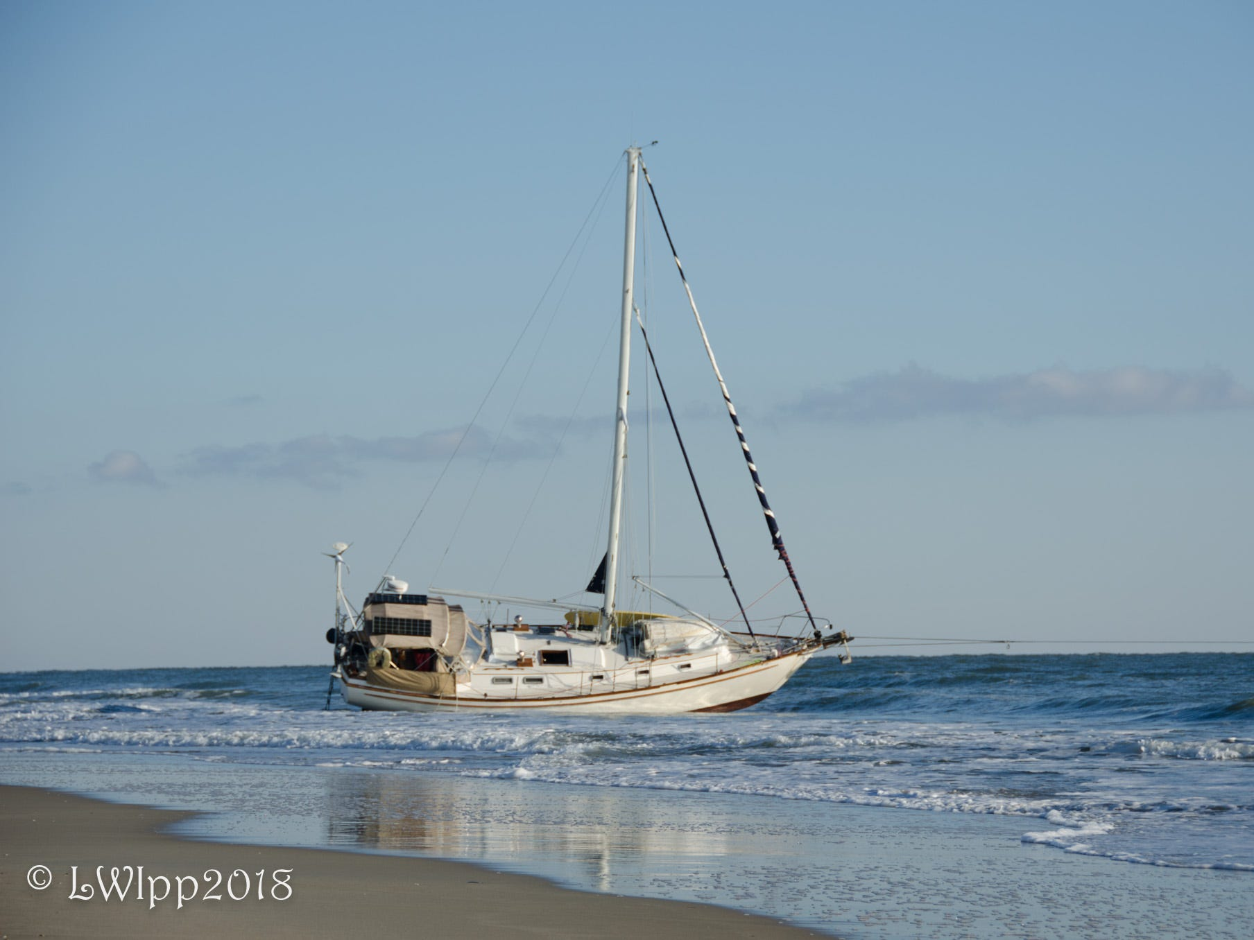 Ocean City: Three rescued by Coast Guard after sailboat runs aground