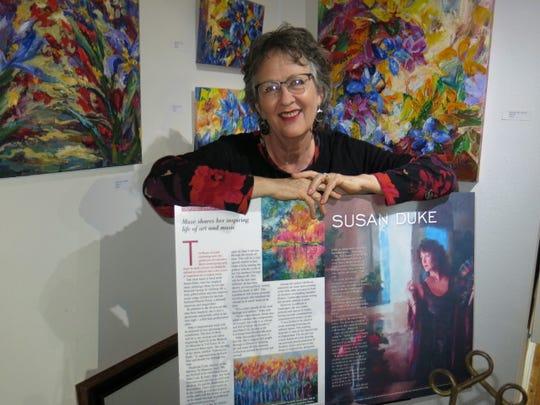 "Artist Susan Duke at SRAC"" Holidaze"" opening."