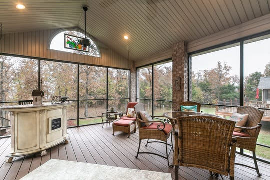 The dry bar on the screened-in deck is what led Cindy to Brian. She says she still loves the piece.