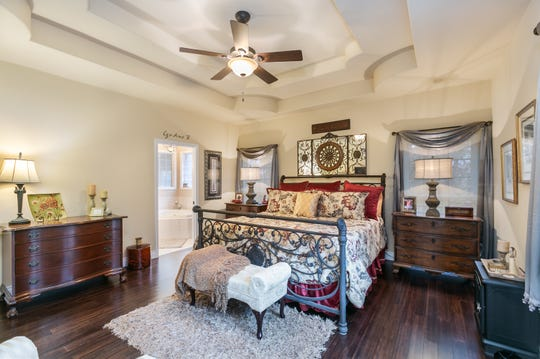 The master suite features a large bath, a very large his-and-hers walk-closet and a somewhat secret passage to Cindy's beauty shop.
