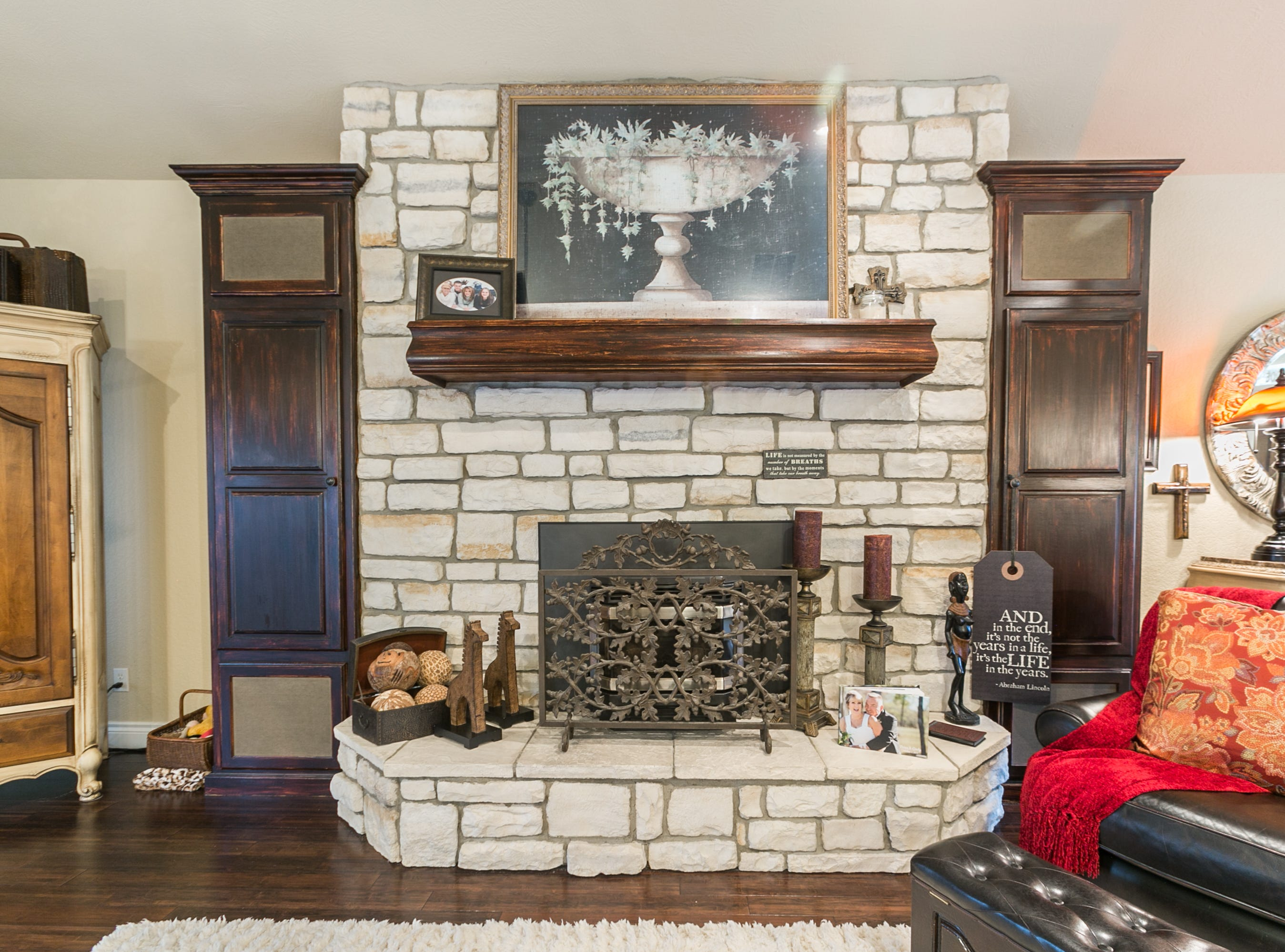 A lovely stone fireplace anchors the living area. Cindy had the wood built-ins and mantel repainted to give them an older, natural feel.