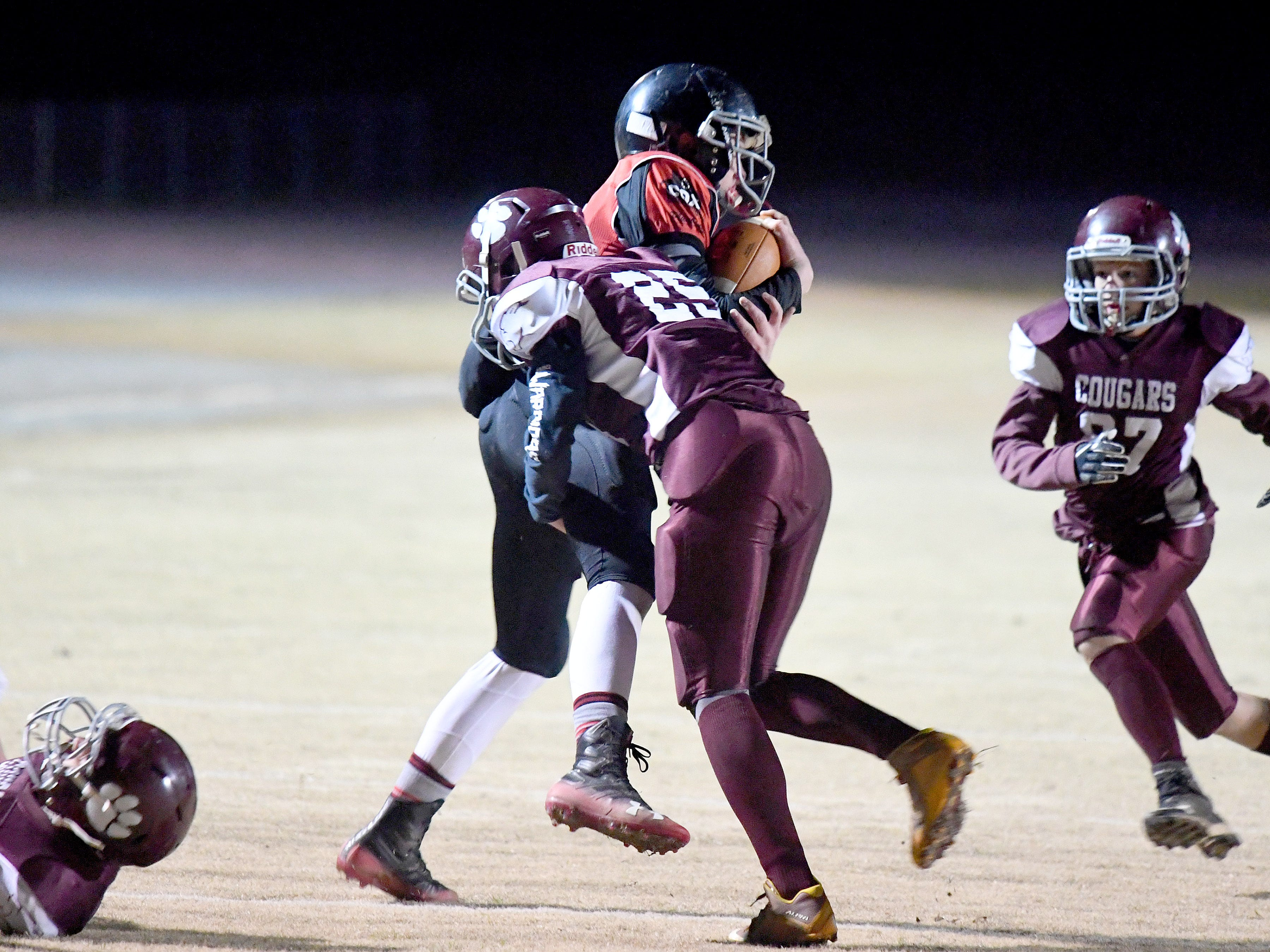 Riverheads' Cayden Cook Cash has the ball as Stuarts Draft's Kyle Coffey makes the tackle during the Augusta County Quarterback Club Seniors Super Bowl in Fishersville on Sunday, Nov. 11, 2018.  RIverheads defeats Stuarts Draft, 38-6.