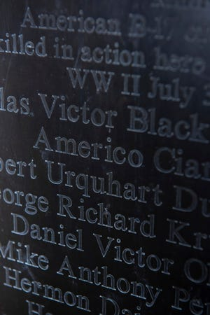Detail of a memorial statue in the village park in Opijnen, Netherlands, showing the names of the U.S. World War II pilots.