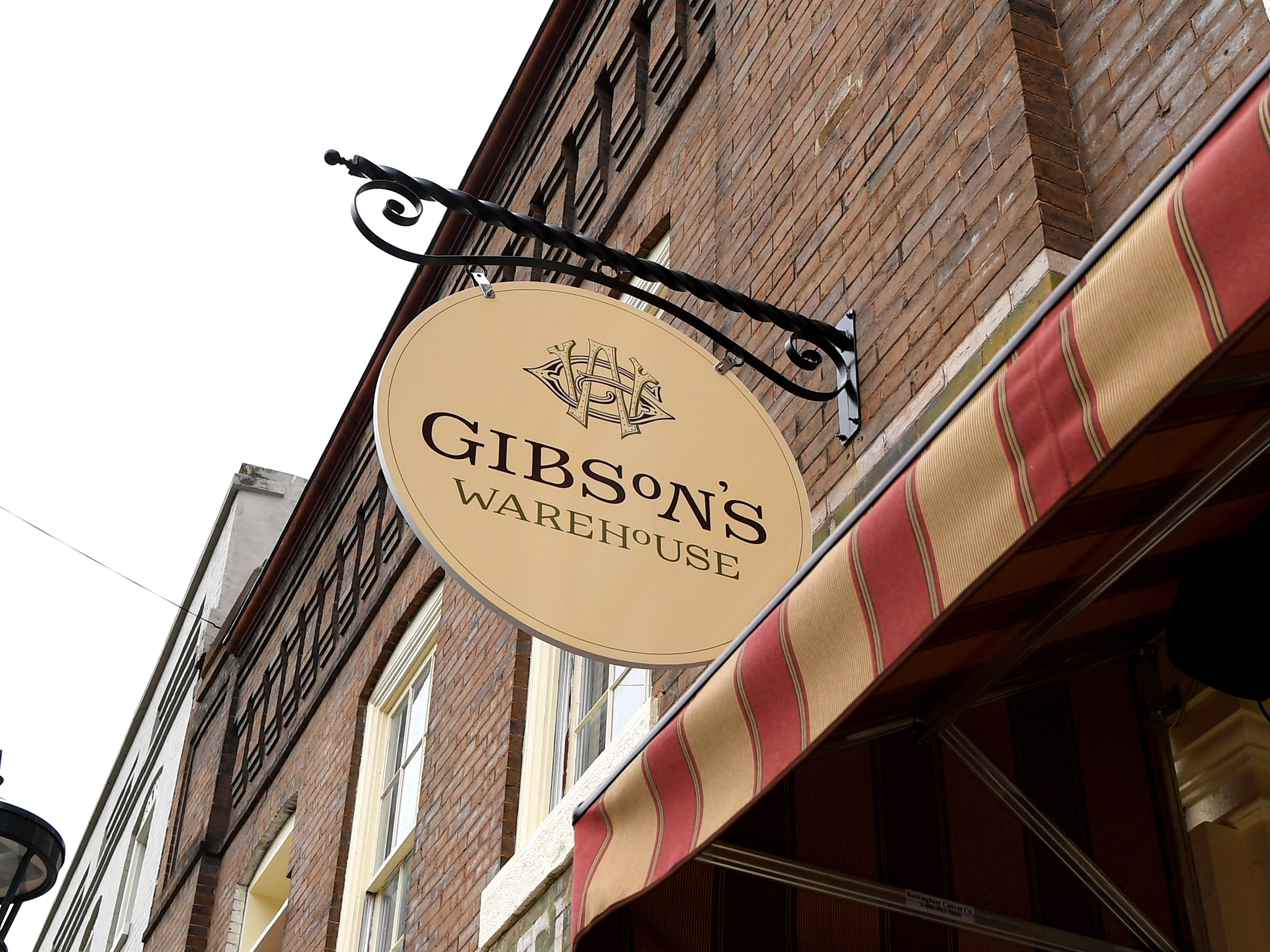 A sign hangs out front of Gibson's Warehouse. Gibson's a boutique hotel located on Middlebrook Avenue, across from the train station in Staunton.