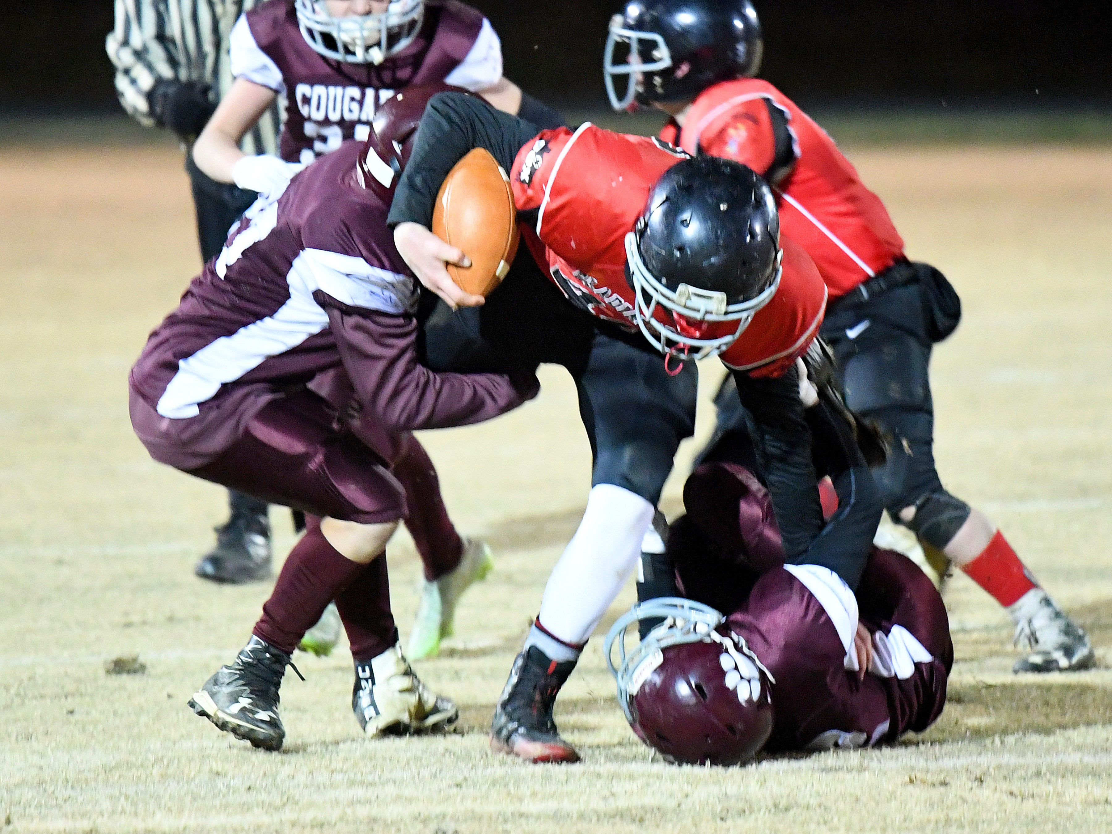 Riverheads' Cayden Cook Cash fights to break a tackle as Stuarts Draft defenders work to make the tackle during the Augusta County Quarterback Club Seniors Super Bowl in Fishersville on Sunday, Nov. 11, 2018.  RIverheads defeats Stuarts Draft, 38-6.