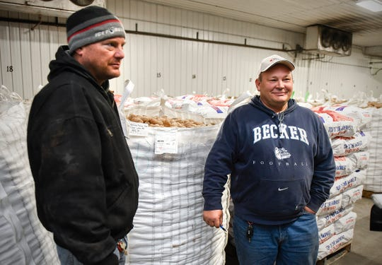 Brothers Brett and Jeff Edling, Edling Farms, Clear Lake, talk about their donation Monday, Nov. 12, of thousands of pounds of potatoes to Union Gospel Mission in St. Paul. The potatoes will feed about 60,000 people on Thanksgiving.