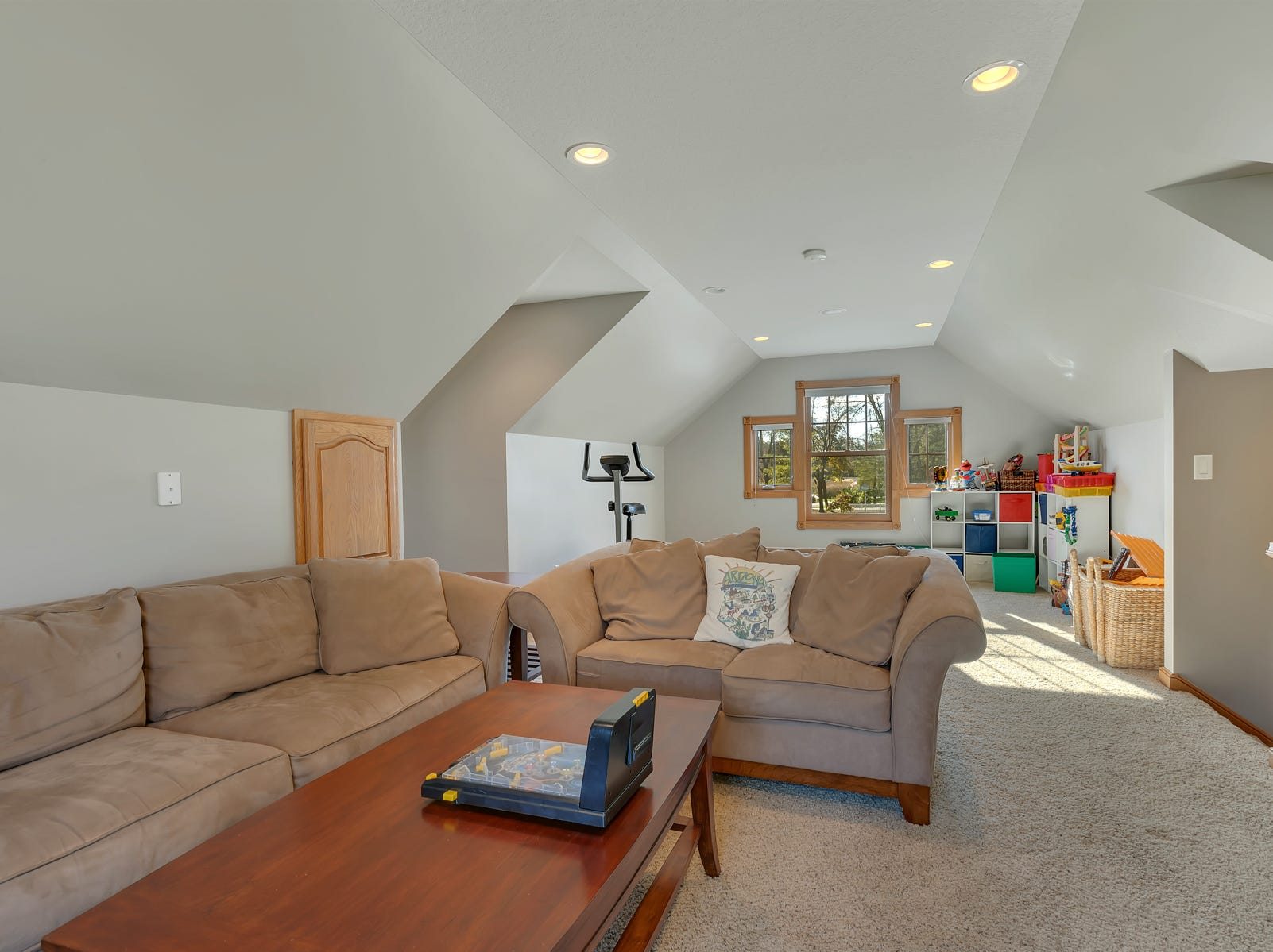 The upper floor has a completely separate section above the garage; a versatile long room that would make for an excellent family room, kids area or guest quarters.