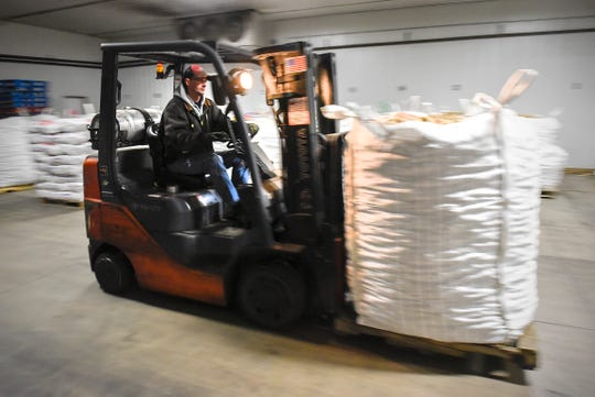 Kent Graning, Edling Farms, Clear Lake, loads thousands of pounds of potatoes in a truck Monday, Nov. 12, to be donated to Union Gospel Mission in St. Paul. The potatoes will feed about 60,000 people on Thanksgiving.