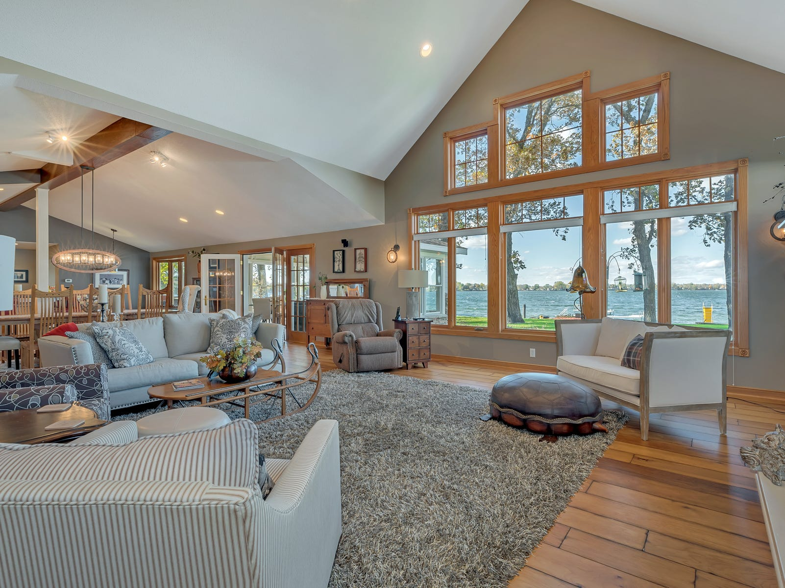 The first floor main area shows off the home's brilliant design and wonderful sightlines to the lake.