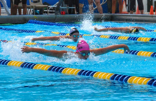 Chiles freshman Lydia Hanlon swims the 100-meter butterfly during the FHSAA Class 3A state meet. Hanlon finished third.