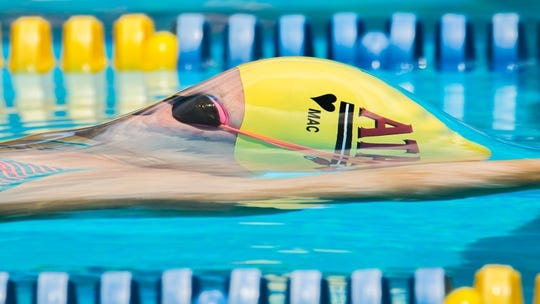 Chiles freshman Lydia Hanlon competes in backstroke during her club season with ATAC.