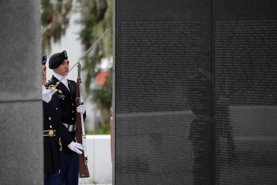 The Tallahassee Veterans Day parade pauses for an 11th Hour Ceremony in front of the Vietnam Veterans Memorial along South Monroe street in downtown Monday, Nov. 12, 2018.
