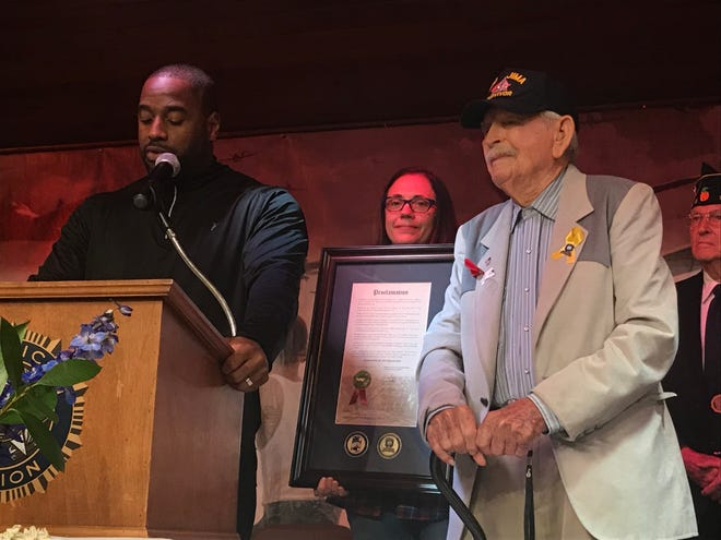 Leon County Commissioner Nick Maddox presents a   proclamation to WWII veteran Edmond Stearman during the Operation Thank You Veterans Day breakfast at the American Legion Sauls-Bridges Post 13 in Tallahassee, Fla. Monday, Nov. 12, 2018.