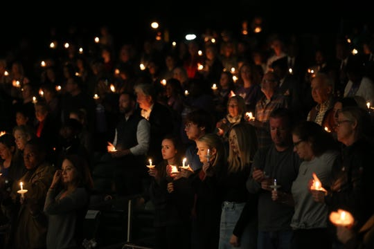 Hundreds gather for a vigil for Maura Binkley and Nancy Van Vessem, who were killed during the shooting at Hot Yoga Tallahassee, at the Hope, Healing, Harmony community event at Cascades Park, Sunday, Nov. 11, 2018.