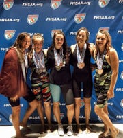 Chiles' Emily Chorpening, Stella Grace Watts, Lydia Hanlon, Virginia Russell and Kealyn Bowie celebrate a successful state meet that landed the Timberwolves in third place.