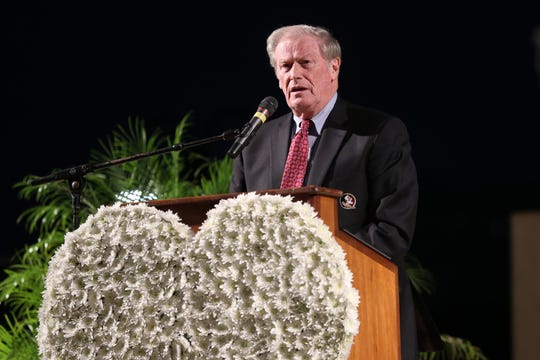 Florida State University President, John Thrasher speaks at a vigil for  Maura Binkley and Nancy VanVessem, who were killed during the shooting at Hot Yoga Tallahassee, at the Hope, Healing, Harmony community event at Cascades Park, Sunday, Nov. 11, 2018.