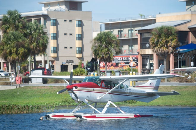 "A Jones Brothers and Company chartered seaplane glides into Lake Dora before taking off to a scenic tour of the Harris Chain of Lakes on Thursday, Nov. 8, 2018, in Tavares. Since investing millions into the seaplane industry and embracing the title of ""America's Seaplane City"" about 10 years ago, the city of about 17,000 residents has ""boomed"" from being home to one restaurant to now offering multiple entertainment-friendly options, including the Key West Resort on Lake Dora (pictured in background), weekend-long events and a wedding pavilion on the lake, according to city administrator John Drury. In addition, the costs stay low with a 3,000 foot, FAA-certified water ""runway"" that requires no lights, no pavement and no maintenance. ""It's a designated airport that costs nothing,"" Drury said."