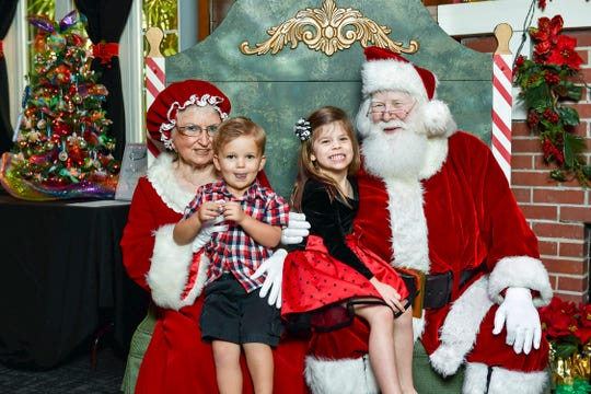 Brando and Carlin Kreps of Stuart enjoy a visit with Santa & Mrs. Claus at the 2017 Tykes & Teens Festival of Trees & Lights. This year's free Breakfast and Photos with Santa will take place Saturday, Dec. 1, from 8:30-10:30 a.m.