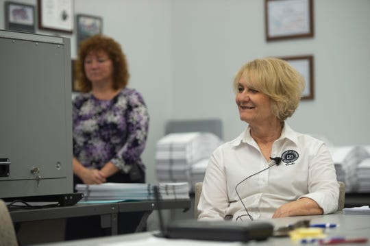 "As observers and lawyers look on, the Martin County Elections Canvassing Board, including Martin County Supervisor of Elections Vicki Davis, recount 78,571 ballots Monday, Nov. 12, 2018 at the Martin County Supervisor of Elections office in Stuart. The board plans to complete the recount Monday with the help of high-powered voting machines. ""We're going until we're done,"" Davis said of the task. Secretary of State Ken Detzner ordered recounts in the elections for governor, U.S. Senator and agriculture commissioner because the results provided to the state from the margin from all three races were less than one-half of one percent."
