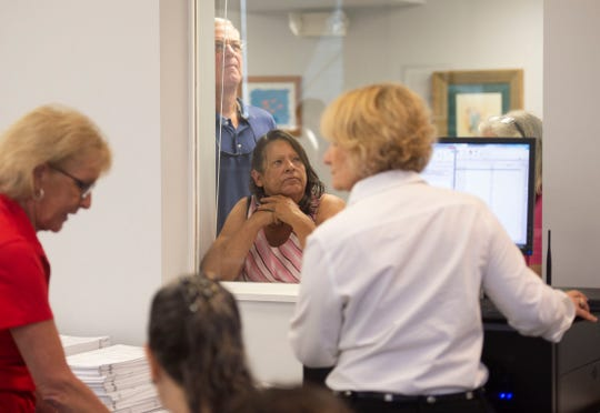 "Observers Scott Webber (back left), of Hobe Sound, and Linda Broda, of Stuart, watch the Martin County Elections Canvassing Board and Supervisor of Elections staff, including Supervisor of Elections Vicki Davis (right), recount 78,571 ballots Monday, Nov. 12, 2018 at the Martin County Supervisor of Elections office in Stuart. ""This is so fascinating to learn how the process works,"" Broda said of experiencing the recount mandated by the Secretary State in the elections for governor, U.S. Senator and agriculture commissioner."