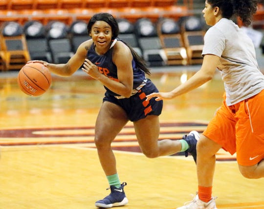 UTEP sophomore point guard Jordan Jenkins, 00, works a play during Monday's practice in the Don Haskins Center.