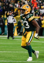 Green Bay Packers' Aaron Jones celebrates his touchdown run during the second half of an NFL football game against the Miami Dolphins on Sunday, Nov. 11, 2018, in Green Bay, Wis.