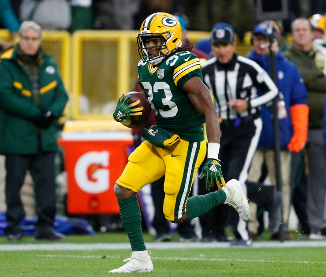 Green Bay Packers' Aaron Jones runs during the first half of an NFL football game against the Miami Dolphins Sunday, Nov. 11, 2018, in Green Bay, Wis. (AP Photo/Matt Ludtke)