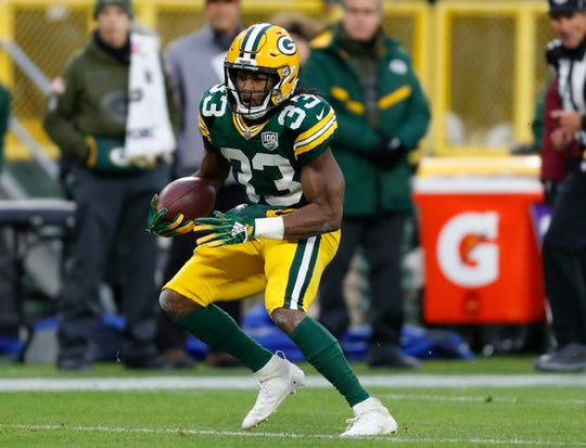 Aaron Jones is shown during the first half of an NFL football game Sunday, Nov. 11, 2018, in Green Bay, Wisconsin.