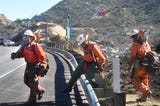 Firefighters tackle the Peak Fire in the hills east of Simi Valley on Monday.