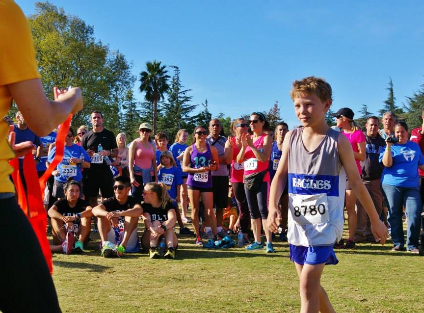 A runner picks up a medal after one of the Conejo Valley YMCA's annual Turkey Day Dashes. This is the 14th year of the run, which will take place Nov. 22 at California Lutheran University in Thousand Oaks.