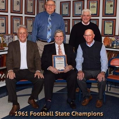 The Millville HIgh School football team won the state title in 1961. Front row L-R- Paul Rozell, Coach Ron Frey, Rob Shannon, Standing- John Lookabaugh, Ed Andrews