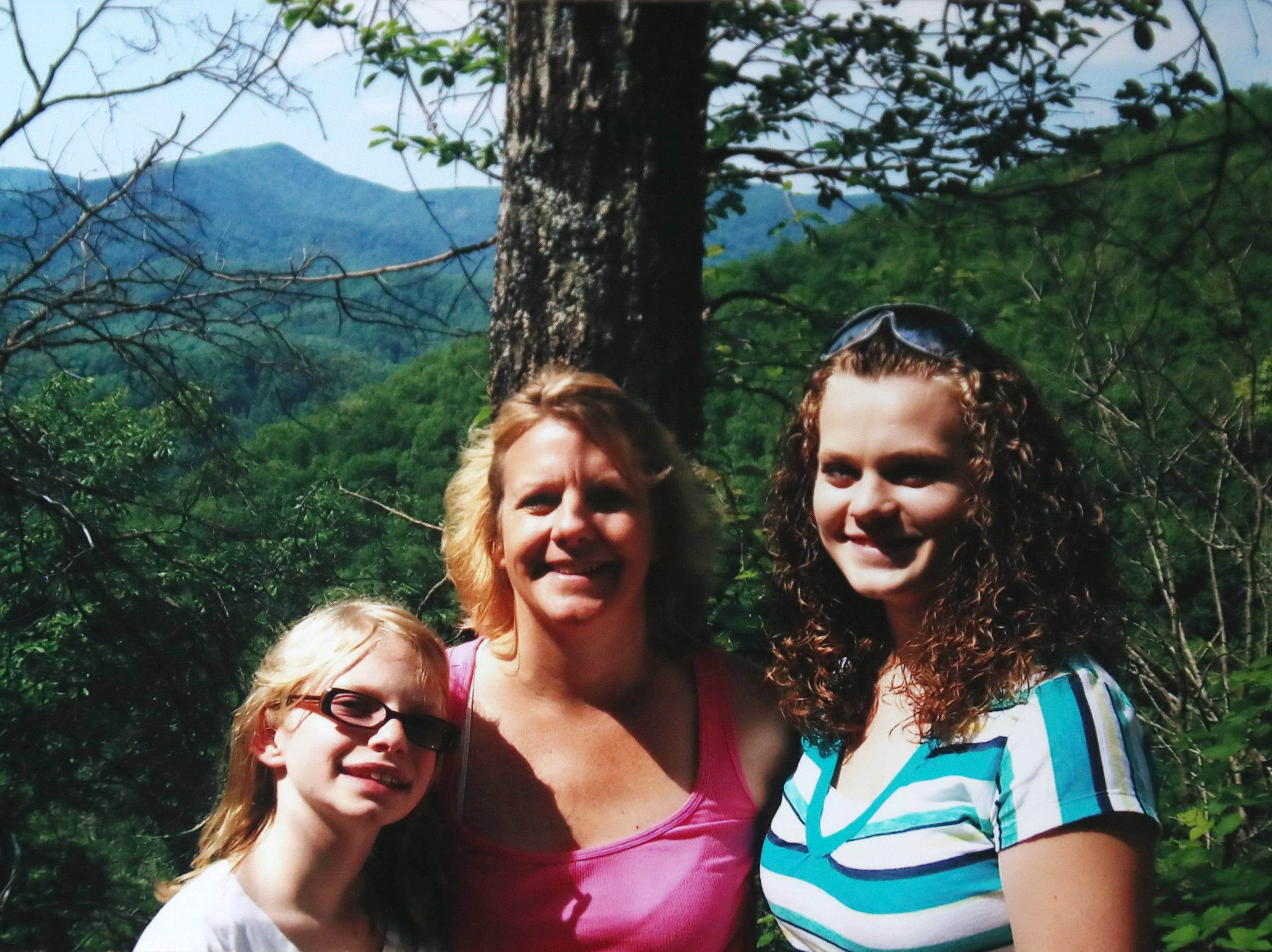 A photo of Morgan Peiper, her mother Kris Cahak, and sister. Morgan was 11-years-old.