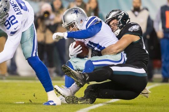 Eagles' Dallas Goedert brings down Dallas' Cole Beasley Sunday at Lincoln Financial Field.
