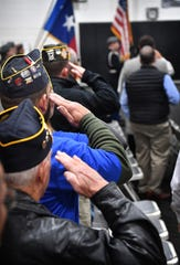 In this file photo, military veterans salute the flag during the National Anthem Monday morning at McNiel Middle School during the Wichita Falls ISD Veterans Day ceremony.